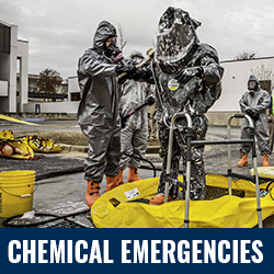 Chemical Emergencies - Photo: People in hazmat suits. Click to learn more about Chemical Emergencies.