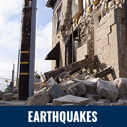 Earthquakes - Photo: Damaged building with pile of debris in front. Click to learn more about earthquakes.