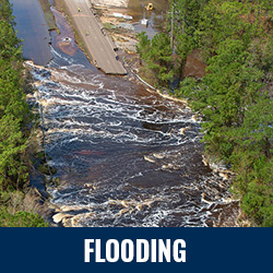 Flooding - Photo: Aerial view of road washed out by flood waters. Click to learn more about flooding.