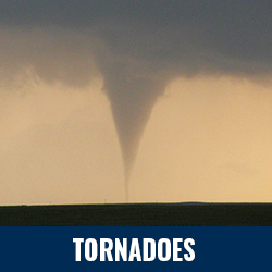 Tornadoes - Photo: Tornado touching down in an open field. Click to learn more about tornadoes.